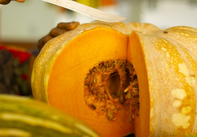 Pumpkin being cut at the market